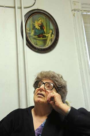 Lilia Perreca Papa, an Italian-American Catholic, watches television as a new Pope is announced on Wednesday, March 13, 2013, at Perreca's Bakery in Schenectady, N.Y. Pope Francis I of Argentina is the first Latin American Pope. (Cindy Schultz / Times Union) Photo: Cindy Schultz / 00021566A