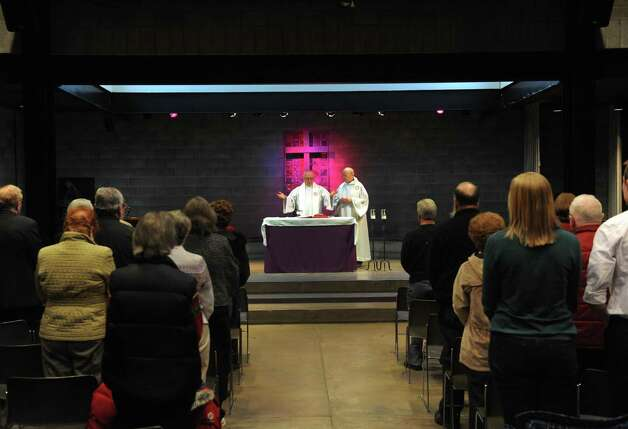Father Ed Kacerguis and Father John Foley lead a  celebration mass for the new Pope at the RPI Chapel and Cultural Center on Wednesday March 13, 2013 in Troy, N.Y. (Michael P. Farrell/Times Union) Photo: Michael P. Farrell