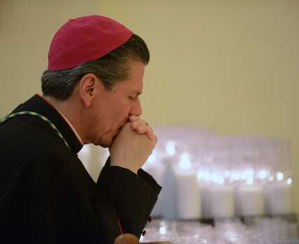 San Antonio Archbishop Gustavo Garcia-Siller prays before a Mass at San Fernando Cathedral in celebration of the selection of an Argentinian cardinal as the new pope on Wednesday, March 13, 2013. Photo: San Antonio Express-News