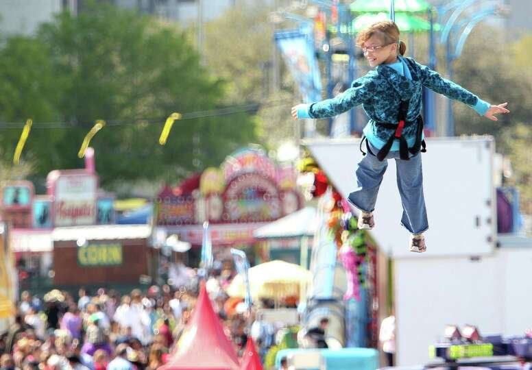 Erika Willumsen, of Katy, glides over the spring breakers while attending the Houston Livestock Show