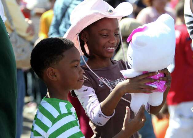 SUNNY DAY: Joseph Paige, 7, looks at the midway prize that his sister, Wendy Paige, 8, won during the Spring Break Stampede at the Houston Livestock Show and Rodeo on Wednesday, March 13, 2013, in Houston. Photo: Mayra Beltran, Houston Chronicle / © 2013 Houston Chronicle