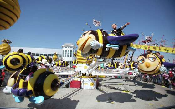 Jonathon Moya, 7, rides the Honey Bee children's ride during the Spring Break Stampede during at the Houston Livestock Show and Rodeo on Wednesday, March 13, 2013, in Houston. Photo: Mayra Beltran, Houston Chronicle / © 2013 Houston Chronicle