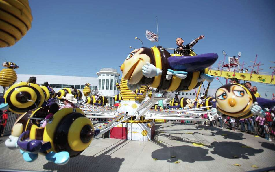 Jonathon Moya, 7, rides the Honey Bee children's ride during the Spring Break Stampede during at the