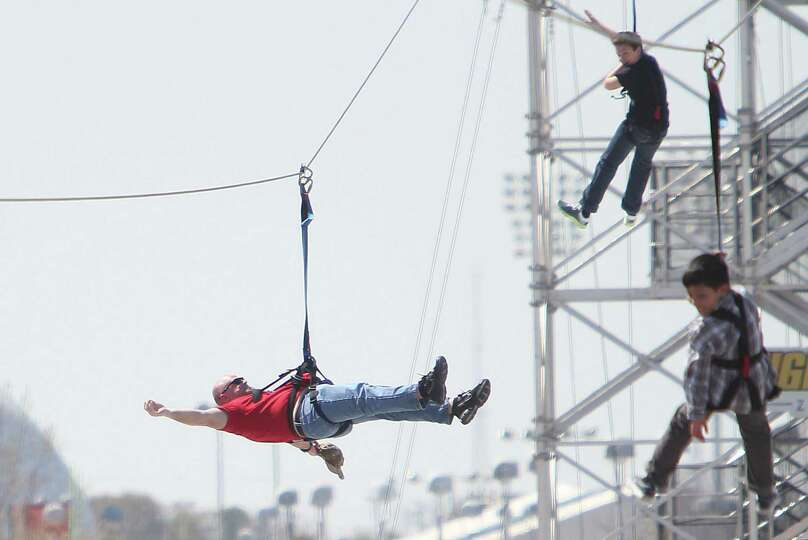 Lee Millis joins his son on the zip line with many others attending the Spring Break Stampede during