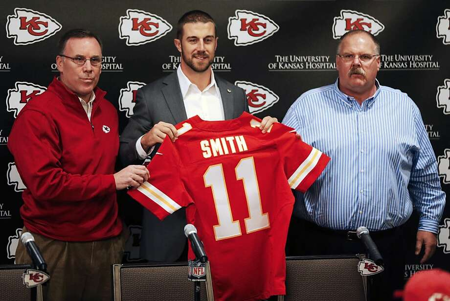 Kansas City Chiefs general manager John Dorsey, left, stands with head coach Andy Reid, right, and newly-signed quarterback Alex Smith following an NFL football news conference at the team's practice facility in Kansas City, Mo., Wednesday, March 13, 2013. (AP Photo/Orlin Wagner) Photo: Orlin Wagner, Associated Press