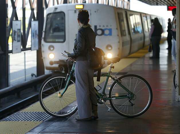 Arielle McKee waits to board a San Francisco-bound BART train that's just arriving at the MacArthur station in Oakland, Calif. on Wednesday, March 13, 2013. Photo: Paul Chinn, The Chronicle