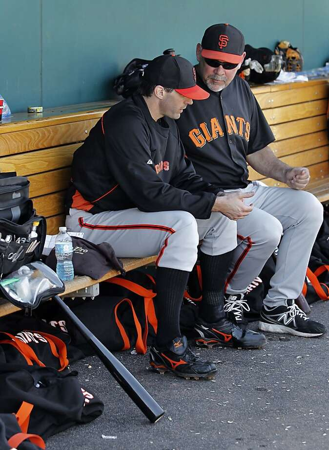 Barry Zito (left) shares a moment with manager Bruce Bochy after Zito was removed from Wednesday's game against Cincinnati. The lefty allowed one run on five hits in 31/3 innings. Photo: Michael Macor, The Chronicle