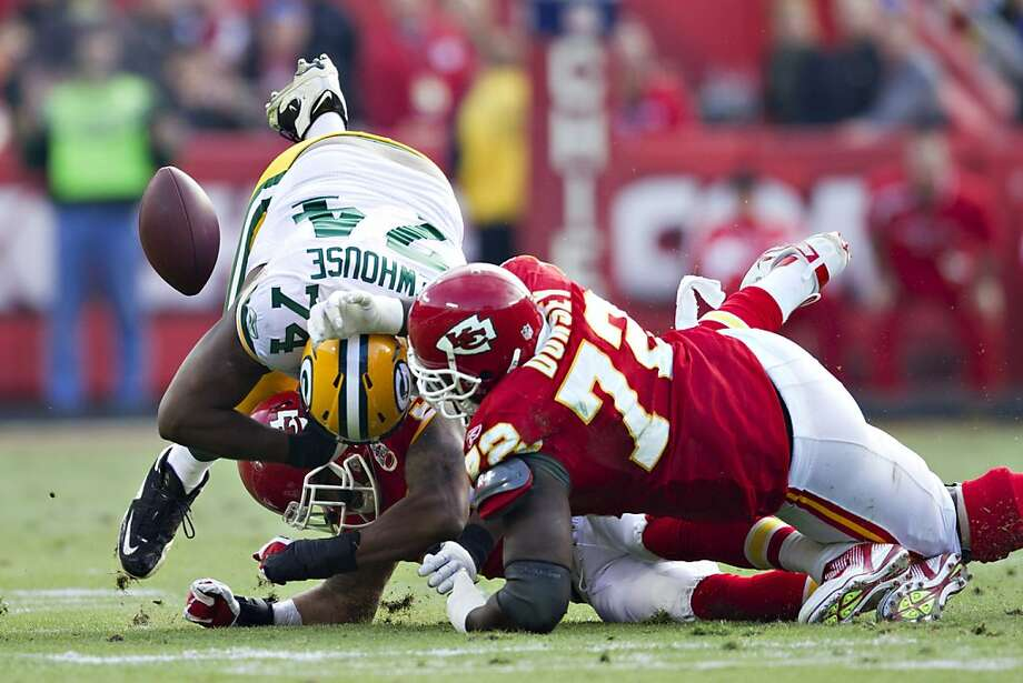 KANSAS CITY, MO - DECEMBER 18:  Marshall Newhouse #74 of the Green Bay Packers fumbles the ball after being tackled by Glenn Dorsey #72 of the Kansas City Chiefs at Arrowhead Stadium on December 18, 2011 in Kansas CIty, Missouri.  The Chiefs defeated the Packers 19-14.   (Photo by Wesley Hitt/Getty Images) Photo: Wesley Hitt, Getty Images