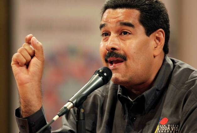Venezuela's acting President Nicolas Maduro speaks at the opening of the Ninth International Book Fair of Venezuela (Filven) which pays tribute to late President Hugo Chavez at the Teresa Carreno theater in Caracas, Venezuela, Wednesday, March 13, 2013. Maduro announced on March 5 that Chavez had died, after a nearly two-year bout with cancer. He was 58. (AP Photo/Ariana Cubillos) Photo: Ariana Cubillos