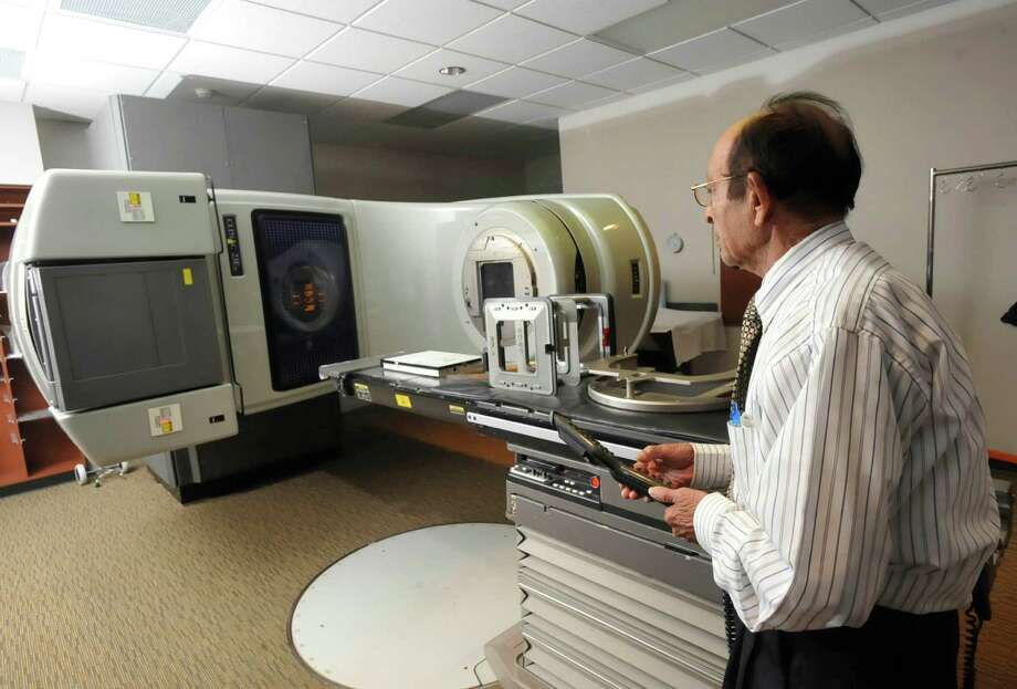 FILE - This Wednesday, Sept. 19, 2102 file photo shows a linear accelerator used to treat cancer at a hospital in Johnstown, Pa. Women treated with radiation for breast cancer are more likely to develop heart problems later, even with the lower doses used today, troubling new research suggests. The risk comes from any amount of radiation, starts five years after treatment and lasts for decades, doctors found. Patients shouldn't panic - radiation has improved cancer survival and that is the top priority, doctors say. The chance of suffering a radiation-induced heart problem is fairly small. The study appears in the Thursday, March 14, 2013 New England Journal of Medicine. (AP Photo/Tribune-Democrat, John Rucosky) THE MORNING CALL OUT; DAILY AMERICAN OUT; WJAC-TV OUT Photo: John Rucosky