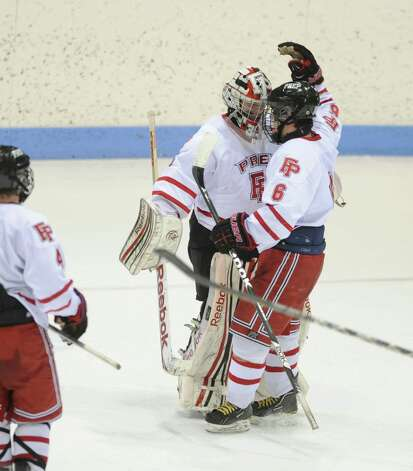 Fairfield Prep goalie Christopher Gutierrez and teammate Kevin Brown celebrate their win over Ridgefield in the boys hockey State Tournament Class I Semifinals Wednesday, Mar. 13, 2013 at Ingalls Rink in New Haven, Conn. Photo: Autumn Driscoll / Connecticut Post