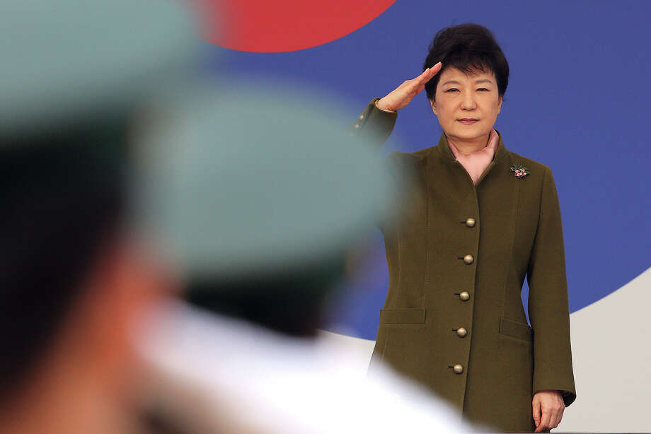 "FILE - In this Friday, March 8, 2013 file photo, South Korean President Park Geun-hye salutes during a joint commission ceremony of 5,780 new officers of Army, Navy, Air Force and Marines at the Gyeryong military headquarters in Gyeryong, south of Seoul, South Korea. The body that controls North Korea's military is dismissing the South Korea's new president with a sexist comment about the ""venomous swish"" of her skirt. An unidentified spokesman for the National Defense Commission's armed forces ministry also repeated North Korean vows from recent days of a ""merciless retaliation"" over ongoing U.S.-South Korean military drills. The statement Wednesday, March 13, reiterates another North Korean promise to no longer abide by the armistice that ended the Korean War. (AP Photo/Yonhap, Ahn Jung-won, File) KOREA OUT Photo: Ahn Jung-won"