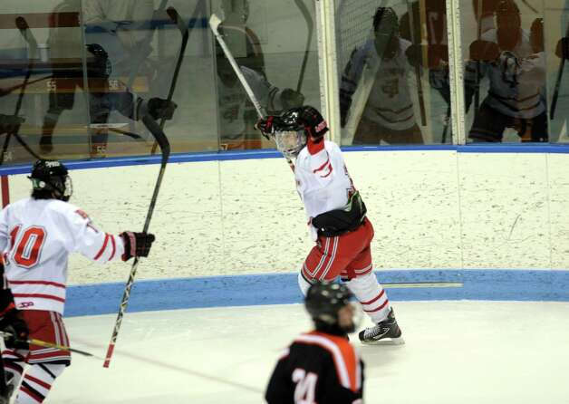 Fairfield Prep celebrates a goal over Ridgefield during the boys hockey State Tournament Class I Semifinals Wednesday, Mar. 13, 2013 at Ingalls Rink in New Haven, Conn. Photo: Autumn Driscoll / Connecticut Post