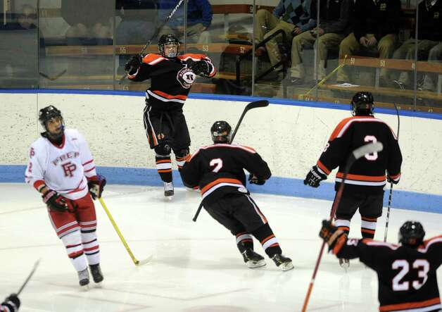 Ridgefield celebrates a goal over Fairfield Prep during the boys hockey State Tournament Class I Semifinals Wednesday, Mar. 13, 2013 at Ingalls Rink in New Haven, Conn. Photo: Autumn Driscoll / Connecticut Post