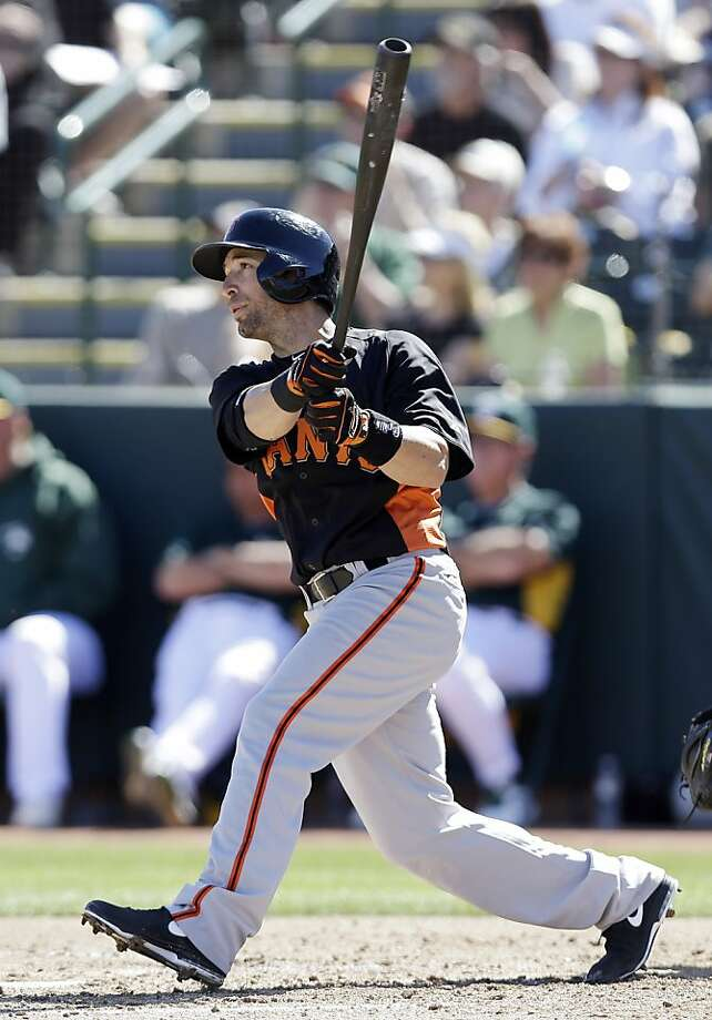 "The Giants' Marco Scutaro takes a cerebral approach to his job. ""You never stop learning from this game,"" the second baseman said. Photo: Marcio Jose Sanchez, Associated Press"