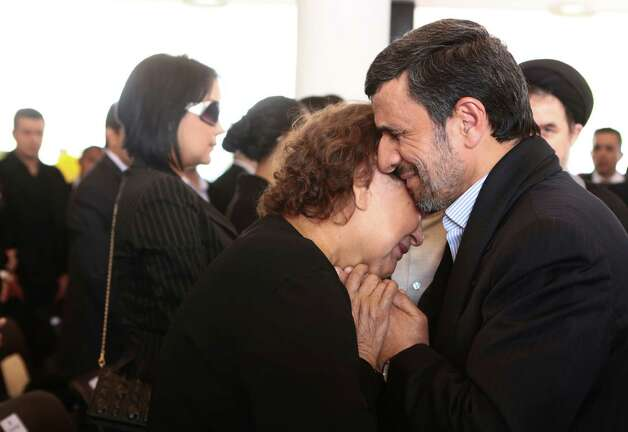 "Iran's President Mahmoud Ahmadinejad didn't kiss Elena Frias - mother of Venezuela's late President Hugo Chavez - but he might as well have, according to Iranian clerics. They decided that the conservative president should not have been ""clowning around"" when consoling Chavez's mother with a hug. It's a physical contact considered a sin under the country's strict Islamic codes ... and it got us to wondering about other notable kisses in history ... at least the ones we could find photos of.(AP Photo/Miraflores Press Office, File) Photo: Getty"