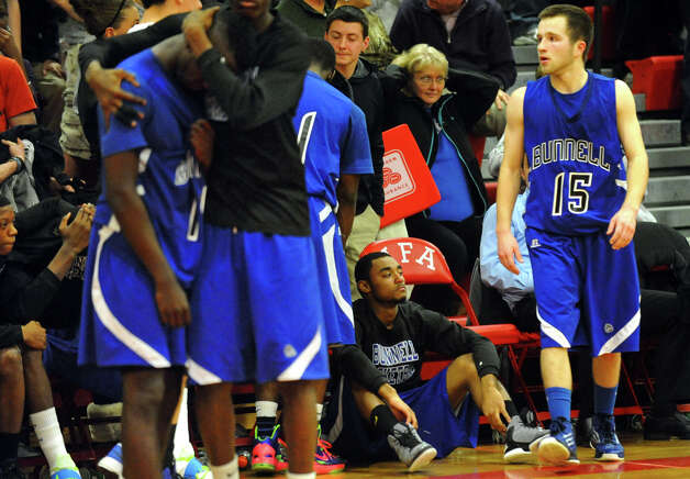 Bunnell team members react to being defeated by Woodstock Academy, during Class L boys basketball semifinal action in Norwich, Conn. on Wednesday March 13, 2013. Photo: Christian Abraham / Connecticut Post