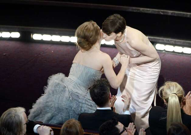 "Actress Amy Adams kisses actress Anne Hathaway after Hathaway wins the Best Supporting Actress award for ""Les Miserables"" during the Oscars held at the Dolby Theatre on Feb. 24, 2013 in Hollywood, California. Photo: Kevin Winter, Getty / 2013 Getty Images"