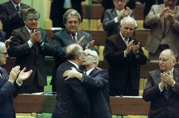 "Now for the kisses that made every politician in the world reconsider, at least for a moment, every kiss they'd ever given another politician. Here Soviet leader Mikhail Gorbachev embraces Erich Honecker, the hardline communist and general secretary of the Communist Party (SED), as East German Prime Minister Willy Stoph (L) looks on, and members of SED applaud during the 11th SED party's congress in 1986 in East Berlin. Honecker ruled East Germany between 1971 and 1989, when he was dismissed as a consequence of the anti-communist revolution.  Stoph was East German Premier between 1964 and 1973 and again between 1976 and 1989. He resigned Nov. 7, 1989, two days before the Berlin Wall was broken down. This picture was later referred to as ""the kiss of death."" Photo: WIESELES, Getty / 2012 AFP"