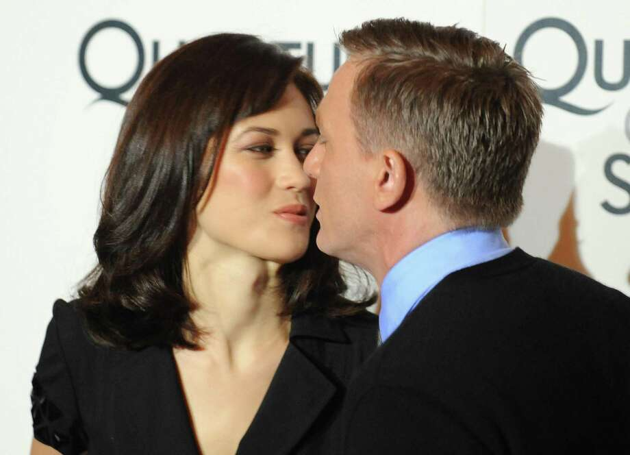 "But we don't see a lot of kissing from Daniel Craig as James Bond. Here he sort of plants one on Ukrainian actress Olga Kurylenko during the photocall for ""Quantum of Solace"" in Rome.  Photo: ALBERTO PIZZOLI, Getty / 2008 AFP"