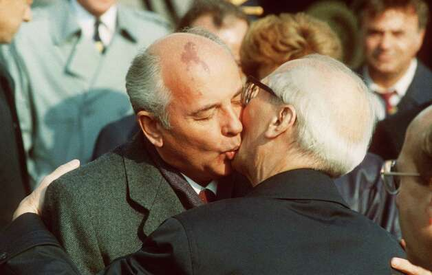Wait, another one. Soviet leader Mikhail Gorbachev, left, embraces Honecker during the celebration of the 40th anniversary of the German Democratic Republic's creation in East Berlin. Gorbachev advised Honecker to heed the 'impulses' of the times. Honecker, the leader of East Germany for 18 years, was ousted 18 October 1989 by his own party and the wall came down. Photo: AFP, Getty / 2007 AFP
