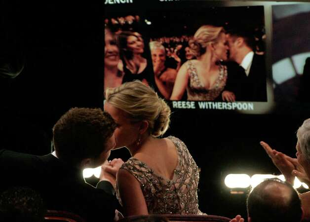 Actress Reese Witherspoon kisses Ryan Phillippe before she goes onstage to accept the Best Actress Award during the 78th Annual Academy Awards at the Kodak Theatre on March 5, 2006 in Hollywood, Calif. Photo: Kevin Winter, Getty / 2006 Getty Images