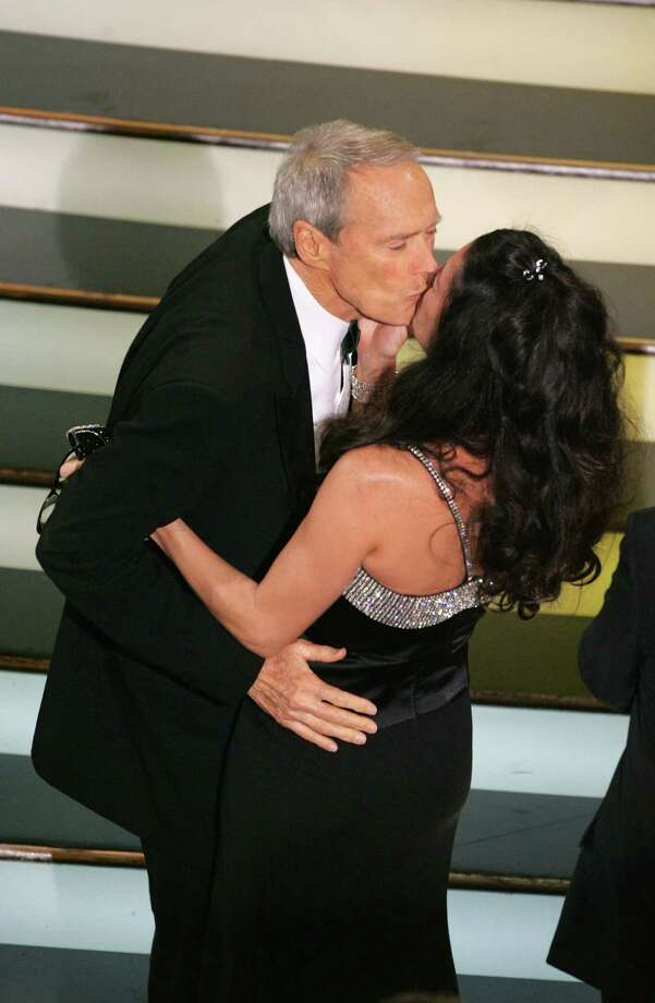Clint Eastwood kisses wife Dina Ruiz Eastwood after winning Best Director during the 77th Annual Academy Awards on February 27, 2005 at the Kodak Theater in Hollywood, Calif. Photo: Kevin Winter, Getty / 2005 Getty Images