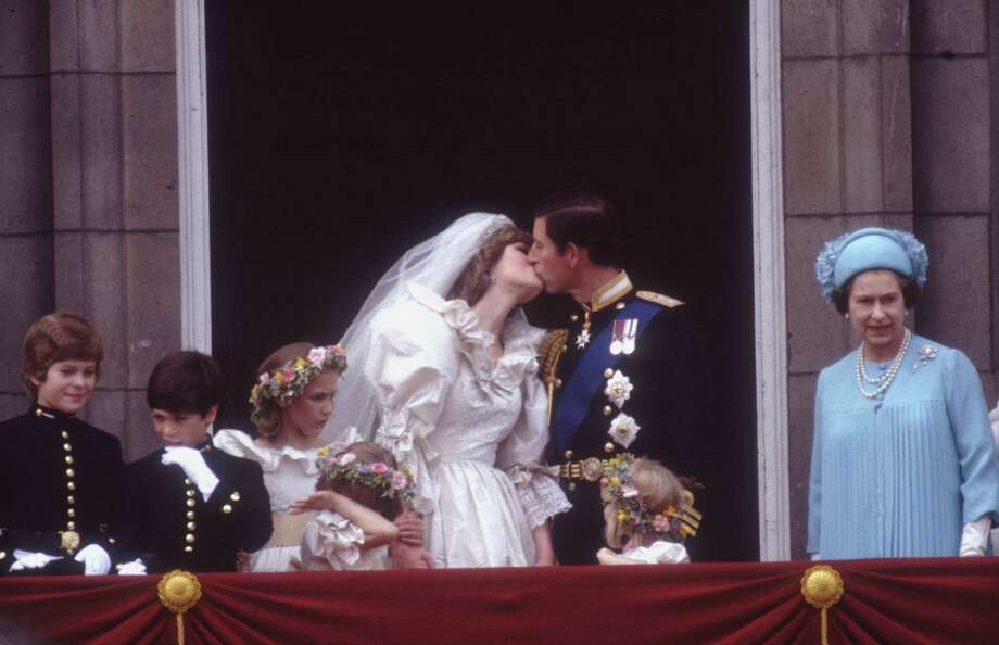 Something about royal weddings gets people all interested. Here, Prince Charles, Prince of Wales, kissed his wife Princess Diana (1961-97) on the balcony of Buckingham Palace in London after their marriage. Photo: Hulton Archive, Getty / Hulton Royals Collection