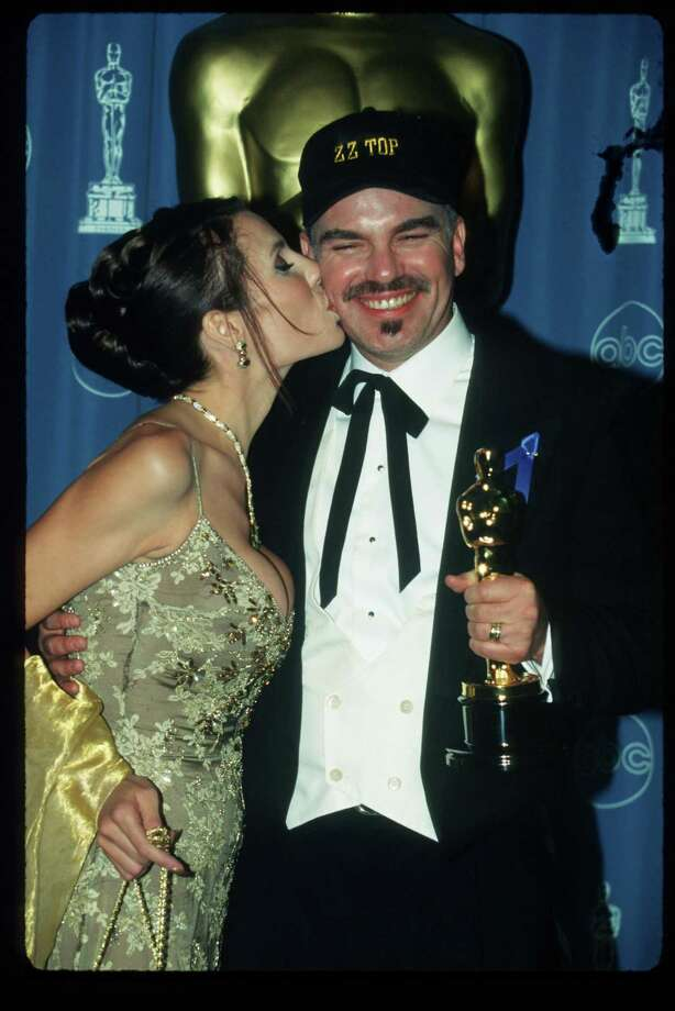 Billy Bob Thornton holds his award while his wife Pietra kisses him at the 69th Annual Academy Awards ceremony March 24, 1997 in Los Angeles. Photo: Russell Einhorn, Getty / Getty Images North America