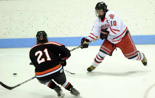 Fairfield Prep's Connor Henry controls the puck as Ridgefield's Cameron McGuire defends during the boys hockey State Tournament Class I Semifinals Wednesday, Mar. 13, 2013 at Ingalls Rink in New Haven, Conn. Photo: Autumn Driscoll / Connecticut Post