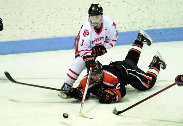 Fairfield Prep's Matt Wikman moves the puck past fallen Ridgefield defender Vincent Rella during the boys hockey State Tournament Class I Semifinals Wednesday, Mar. 13, 2013 at Ingalls Rink in New Haven, Conn. Photo: Autumn Driscoll / Connecticut Post