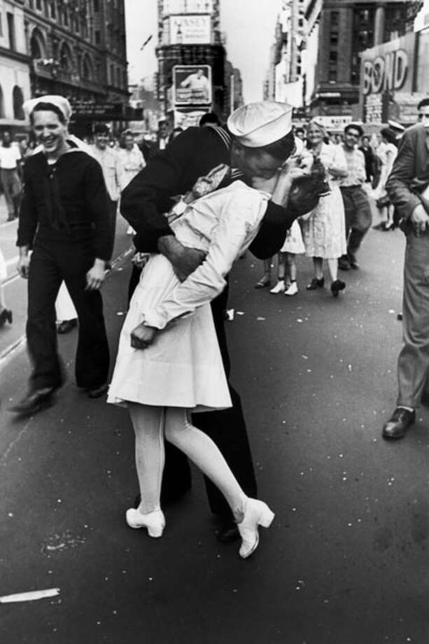 "A kiss that wasn't rebuffed and became THE kiss against which all other celebratory kisses in public places has been measured against. Original caption:  ""A jubilant American sailor clutching a white-uniformed nurse in a back-bending, passionate kiss as he vents his joy while thousands jam Times Square to celebrate the long awaited-victory over Japan."" Photo: Alfred Eisenstaedt, Getty / Time & Life Pictures"