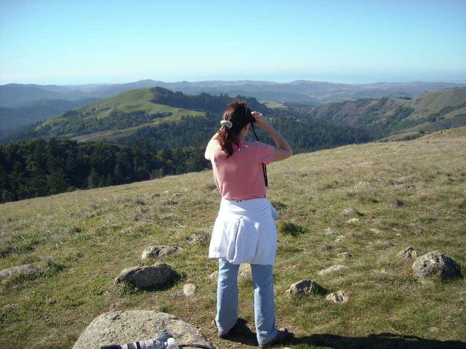 My sister Susan takes in view from Borel Hill at Russian Ridge Open Space Preserve