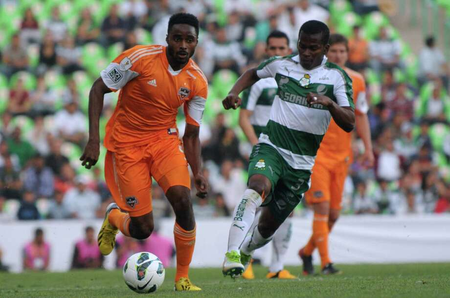 Darwin Quintero of Santos vies for the ball with Warren Creavalle of the Dynamo during the CONCACAF Champions League quarterfinal in Torreon, Mexico. Photo: LUIS FUENTES, AFP/Getty Images / AFP