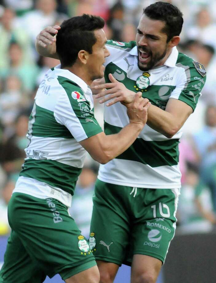 Herculez Gomez celebrates with a teammate after the second goal against the Dynamo. Photo: ANDRES HERRERA, AFP/Getty Images / AFP