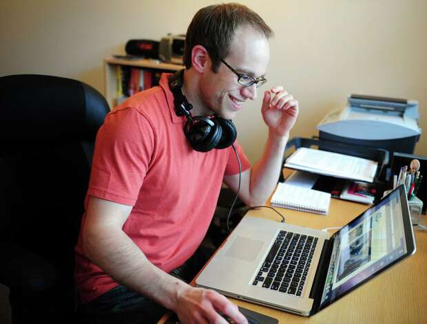 Entertainment journalist Adam Bernard is one of many telecommuters in Southwestern Connecticut. Bernard works from his home in Fairfield, Conn. Photo: Autumn Driscoll / Connecticut Post