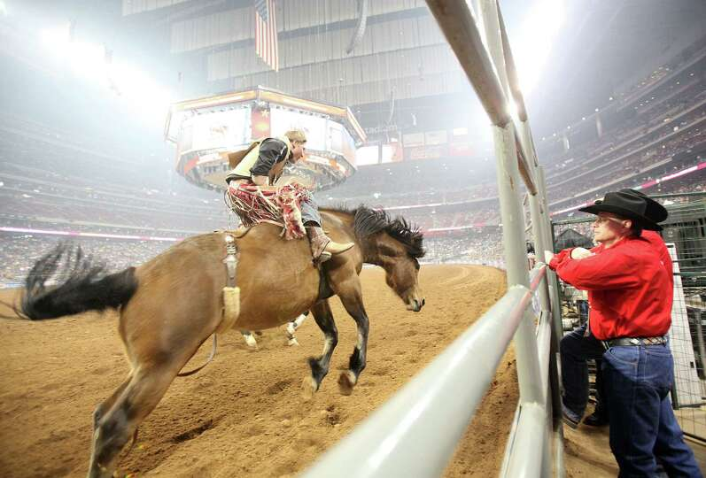 Ty Breuer competes in Bareback Riding during the BP Super Series Semifinals 1 at Reliant Stadium on