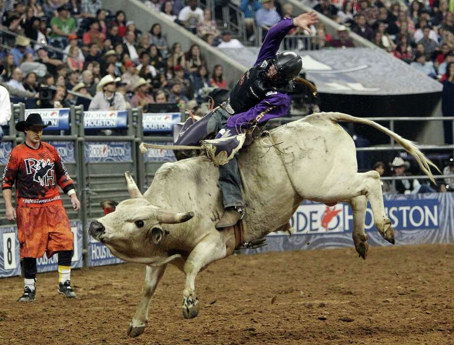 Cody Whitney competes in Bull Riding during the BP Super Series Semifinals 1 at Reliant Stadium on Wednesday, March 13, 2013, in Houston. Photo: Mayra Beltran, Houston Chronicle / © 2013 Houston Chronicle