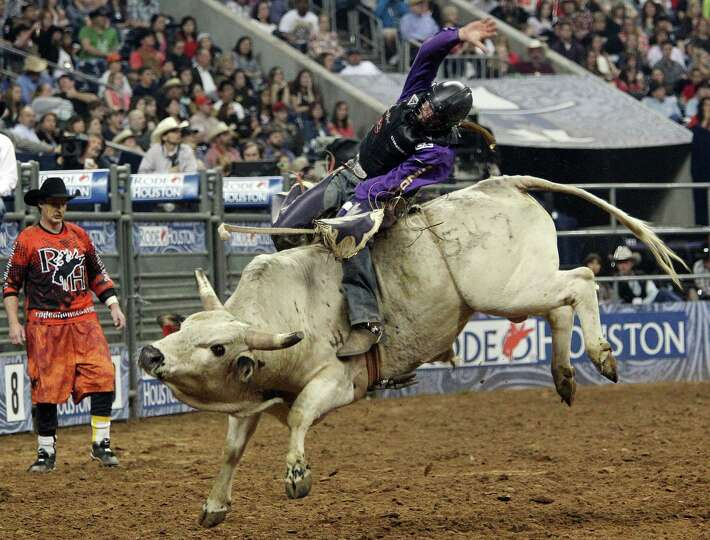 Cody Whitney competes in Bull Riding during the BP Super Series Semifinals 1 at Reliant Stadium on W