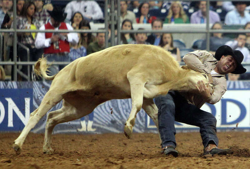 Olin Hannum competes in Steer Wrestling during the BP Super Series Semifinals 1 at Reliant Stadium o