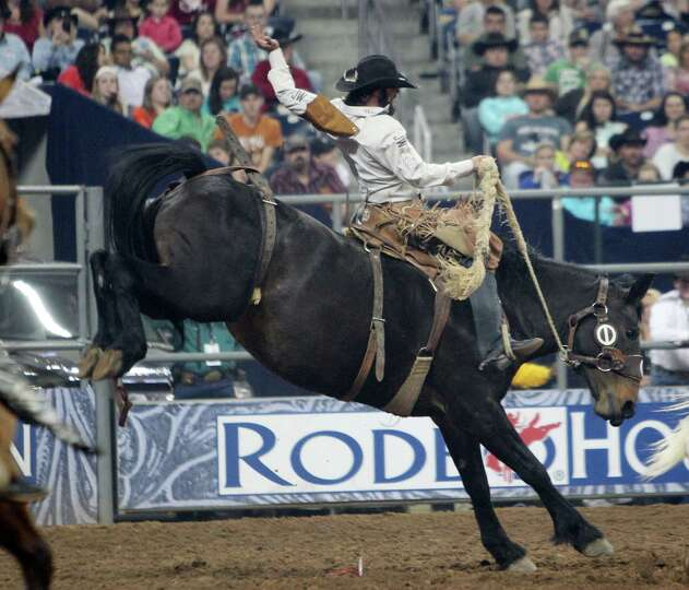 Wade Sundell competes in Saddle Bronc Riding during the BP Super Series Semifinals 1 at Reliant Stad