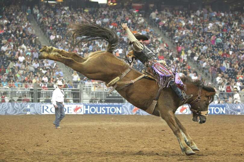 Cody Wright competes in Saddle Bronc Riding during the BP Super Series Semifinals 1 at Reliant Stadi
