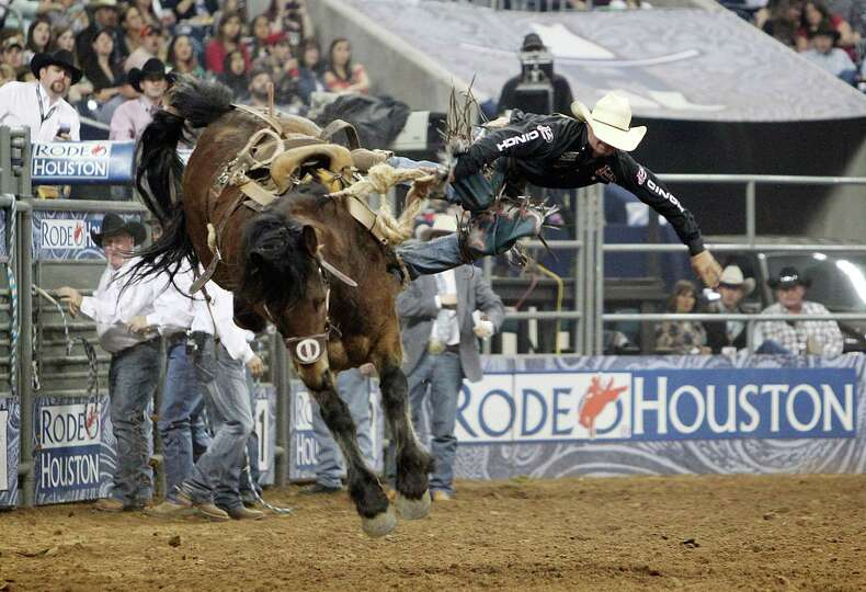 Heith Demoss competes in Saddle Bronc Riding during the BP Super Series Semifinals 1 at Reliant Stad