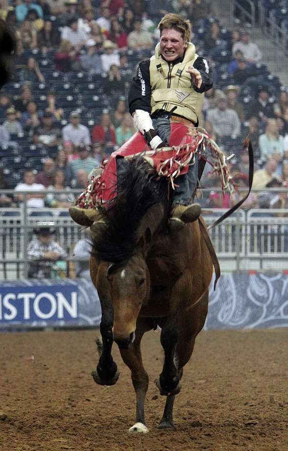 Ty Breuer competes in Bareback Riding during the BP Super Series Semifinals 1 at Reliant Stadium on Wednesday, March 13, 2013, in Houston. Photo: Mayra Beltran, Houston Chronicle / © 2013 Houston Chronicle