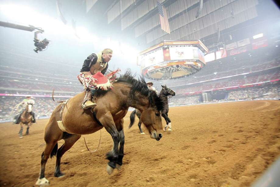 Ty Breuer competes in Bareback Riding during the BP Super Series Semifinals 1 at Reliant Stadium on Wednesday, March 13, 2013, in Houston. ( Photo: Mayra Beltran, Houston Chronicle / © 2013 Houston Chronicle