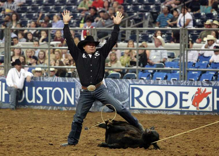 Matt Shiozawa competes in Tie-Down Roping during the BP Super Series Semifinals 1 at Reliant Stadium
