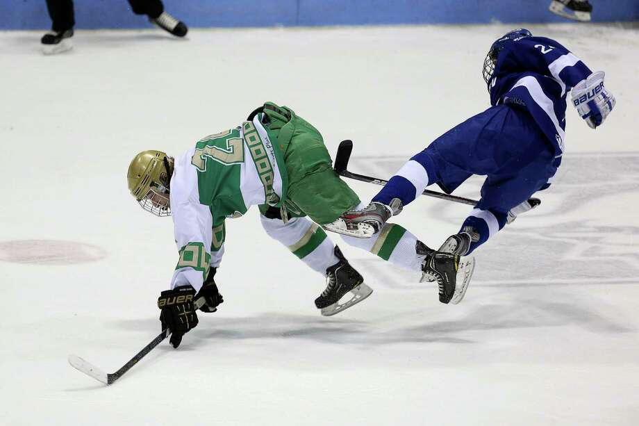 Mike Ross Connecticut Post freelance -Notre Dame of West Haven #24 Eric Austin and Darien High School's #24 Dillion Fitzpatrick collide during first period action of Wednesday evening CIAC State Semifinals. Photo: Mike Ross / www.mikerossphoto.com