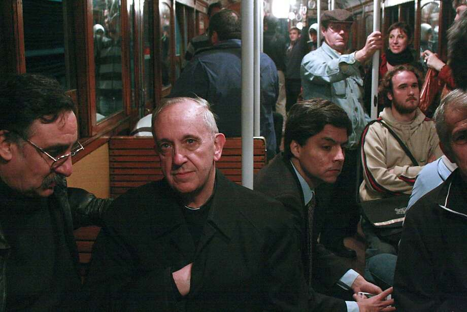 In this 2008 photo, Argentina's Cardinal Jorge Mario Bergoglio, second from left, travels on the subway in Buenos Aires, Argentina. Bergoglio, named pope on Wednesday, March 13, 2013, was known for taking the subway and mingling with the poor of Buenos Aires while archbishop. Bergoglio chose the name Pope Francis and is the first pope ever from the Americas. Photo: Pablo Leguizamon, Associated Press
