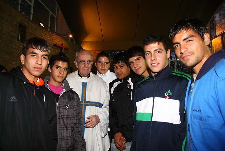 Handout photo released by San Lorenzo football club press service of Argentinian cardinal Jorge Mario Bergoglio posing with teenagers in Buenos Aires. Bergoglio was elected Pope on March 13, 2013, to replace the frail Benedict XVI as leader of the world's 1.2 billon Catholics. Photo: Ho, AFP/Getty Images
