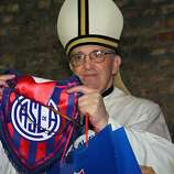 Undated file photo of Argentina's cardinal Jorge Mario Bergoglio posing with the emblem of San Lorenzo's football team, which he supports in Buenos Aires. Bergoglio has been elected Pope on March 13, 2013, to replace the frail Benedict XVI as leader of the world's 1.2 billon Catholics.